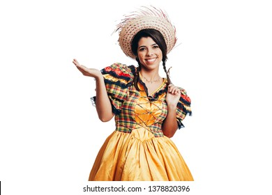Brazilian woman wearing typical clothes for the Festa Junina showing something isolated on white background