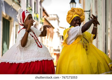 "Brazilian women ""Baianas"" with local costume in Pelourinho dancing, Salvador, Bahia"