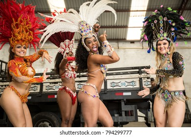 Brazilian women dancing samba music for the carnival in an old factory