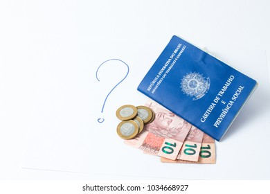 Brazilian work document and social security document (carteira de trabalho) with money as a concept of how little money the worker make - question mark as a question of job Copy Space