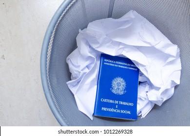 Brazilian work document in a trash can to protest against new reform of work and pension law (Portuguese: Carteira de trabalho no lixo contra perda de direitos na reforma trabalhista e da previdência)