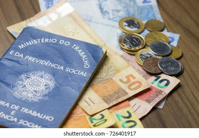 Brazilian work permit, official document on a table accompanied by Brazilian money notes. selective focus