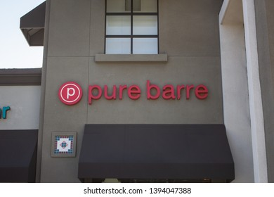 Brea, California/United States - 04/17/2019: A store front sign for the boutique stylized fitness gym known as Pure Barre