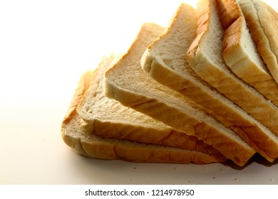 Bread background / Bread is a staple food prepared from a dough of flour and water usually by baking.