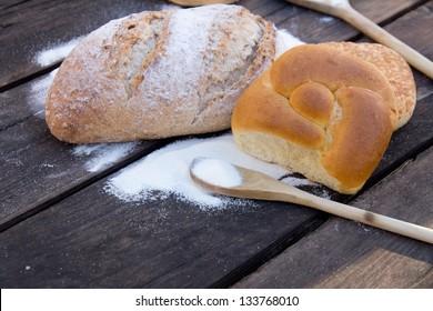 Bread, bagels, wood spoon and salt