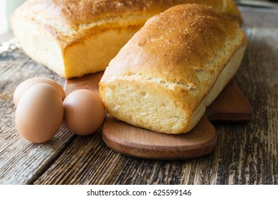 bread baked in the oven and eggs on the table