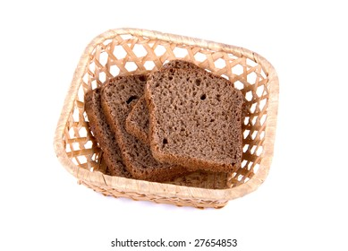 Bread at basket isolated on white