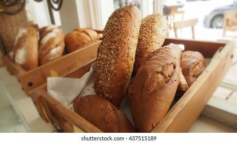 Bread  in basket on shelf in bakery or baker's shop