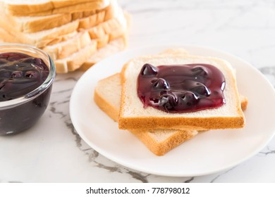 bread with blueberry jam for breakfast