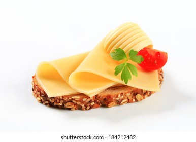 Bread with butter and sliced cheese