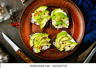 bread with cheese and avocado on a table