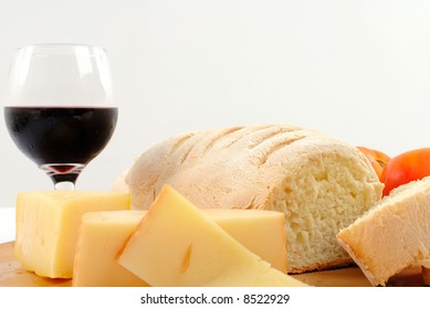 Bread and Cheese food with a wine glass.