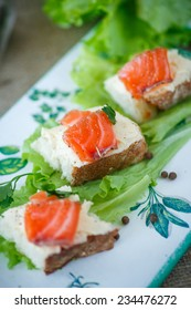 bread with cheese and salted salmon with lettuce