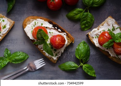 Bread cheese spread baked tomato, fresh basil on top