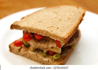 bread cheeseburger on plate