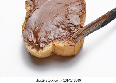 Bread with chocolate nougat cream. Breakfast
