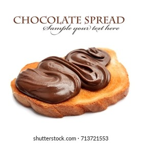 Bread with chocolate spread closeup on wheat backgrounds.