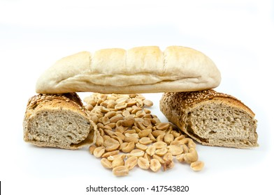 Bread composition and hazelnuts on white background