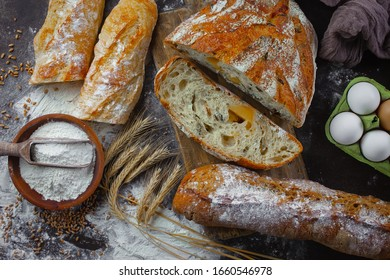 Bread in a composition with kitchen accessories on an old background
