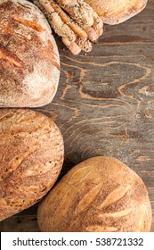 Bread composition on a wooden backround. Variety of homemade organic bread loafs.