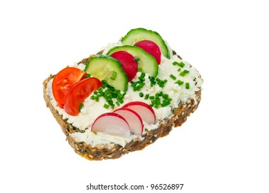a bread with cottage cheese and cheese spread with vegetables and healthy eating.