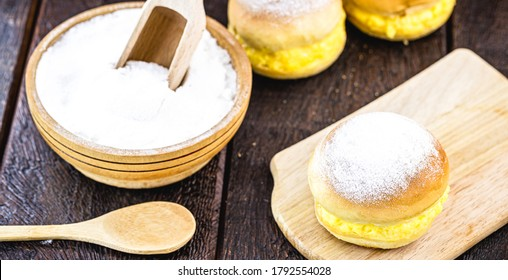 "bread with cream, known as berlin ball, donut without a hole or bakery ""dream"". Typical sweet dob ​​rasil, portugal and germany"
