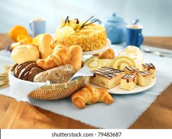 Bread and dessert arrangement on table