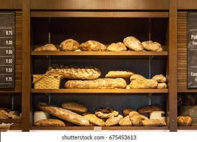 Bread display with wooden shelves and basket