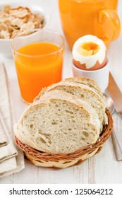 bread with egg, cereals and juice