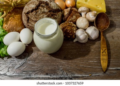 Bread, eggs, cheese, mushrooms, sour cream, on a wooden board