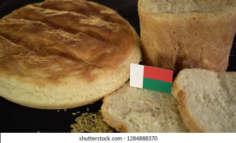 Bread with flag of Madagascar. World wheat import export trade
