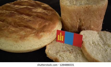 Bread with flag of Mongolia. World wheat import export trade