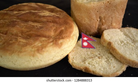 Bread with flag of Nepal. World wheat import export trade