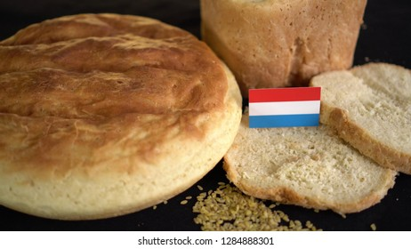 Bread with flag of Netherlands. World wheat import export trade
