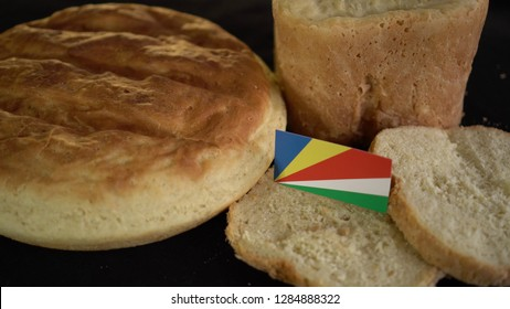 Bread with flag of Seychelles. World wheat import export trade