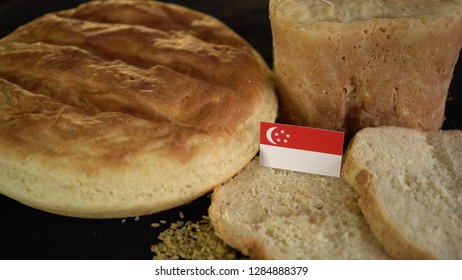 Bread with flag of Singapore. World wheat import export trade