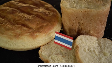 Bread with flag of Thailand. World wheat import export trade