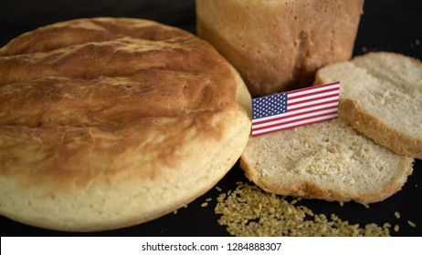 Bread with flag of United States of America. World wheat import export trade