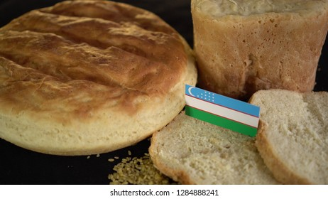 Bread with flag of Uzbekistan. World wheat import export trade