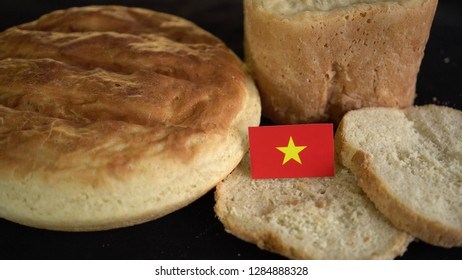 Bread with flag of Vietnam. World wheat import export trade