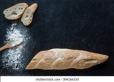 bread and flour on black chalkboard  for bakery background
