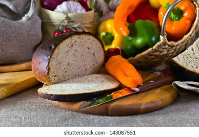 Bread and fresh vegetables on a linen fabric