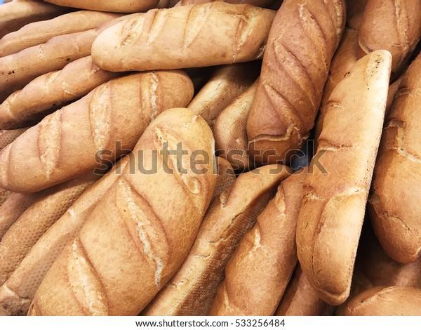 Bread loaves. Loaf of bread. Fresh bread in bakery. Bread loaves background.