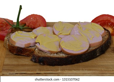 Bread with meat sausage and mustard