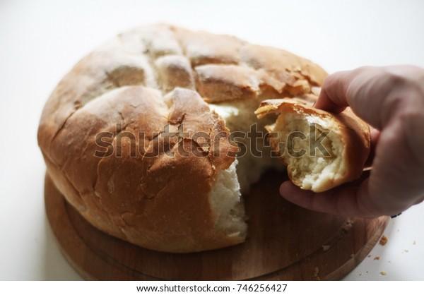 Bread on the board. Breaking bread.