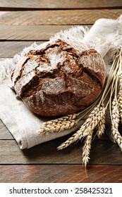Bread on a napkin with ears of wheat, food