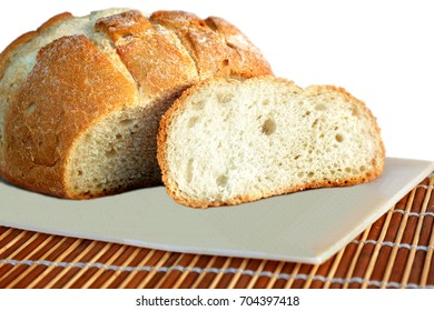 bread on a  table.  Fresh fragrant  bread. Loaf of bread slices on cutting board closeup. Home-made bread on an white  plate