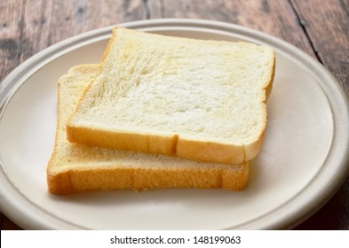 Bread on white dish.