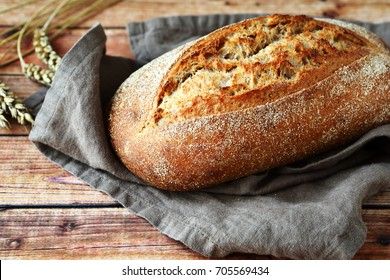 bread on wooden background, food closeup