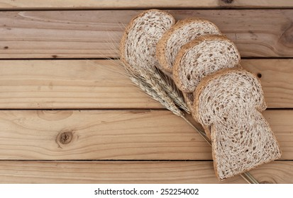 bread on a wooden Table-viewed from above.